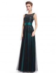 Темно-зеленое платье, расшитое блестками
