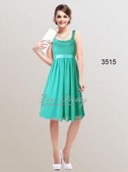 Зеленое коктейльное платье с завышенной талией